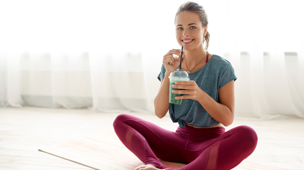 woman working out with smoothie