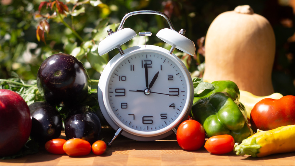 clock surrounded by vegetables