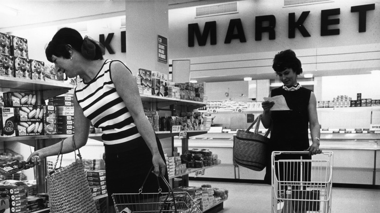 Women shopping at supermarket in the 1970s