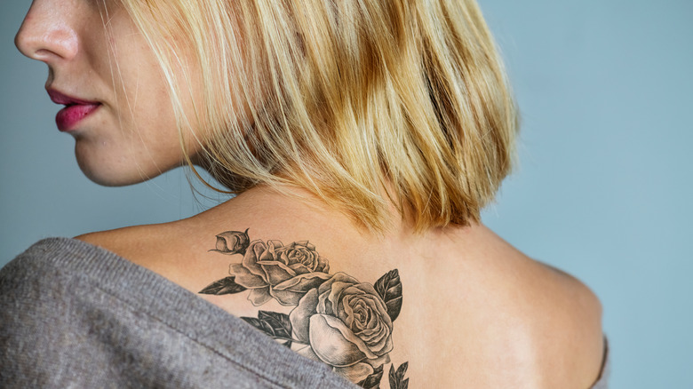 Woman with a rose tattoo on her back