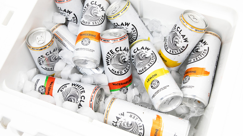 Cans of white claw spiked seltzer in ice chest