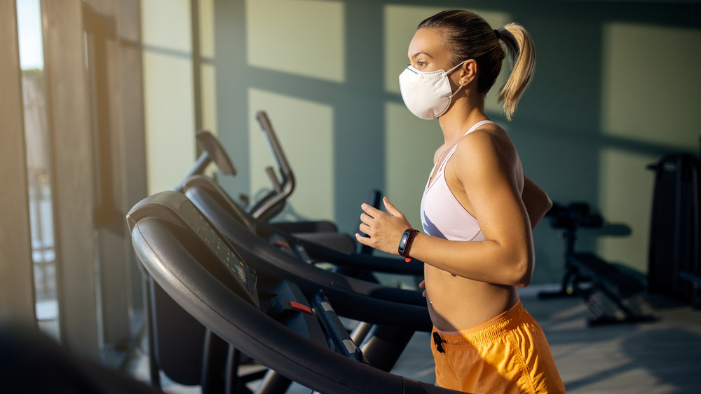 Woman wearing a mask at the gym