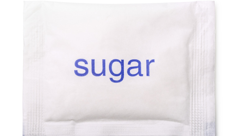 """White packet with word """"sugar"""""""