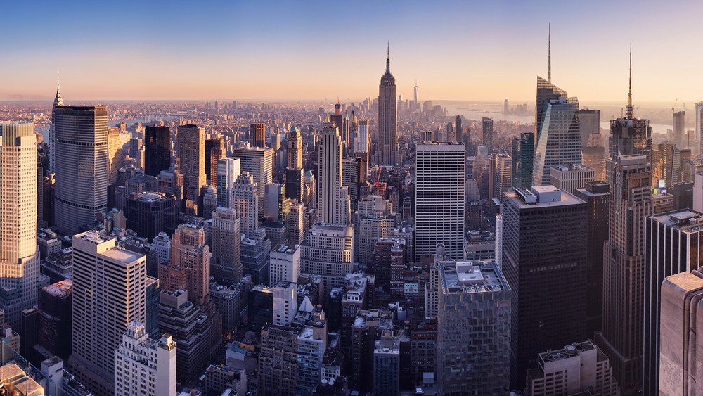 New York City skyline with tall buildings and river in background