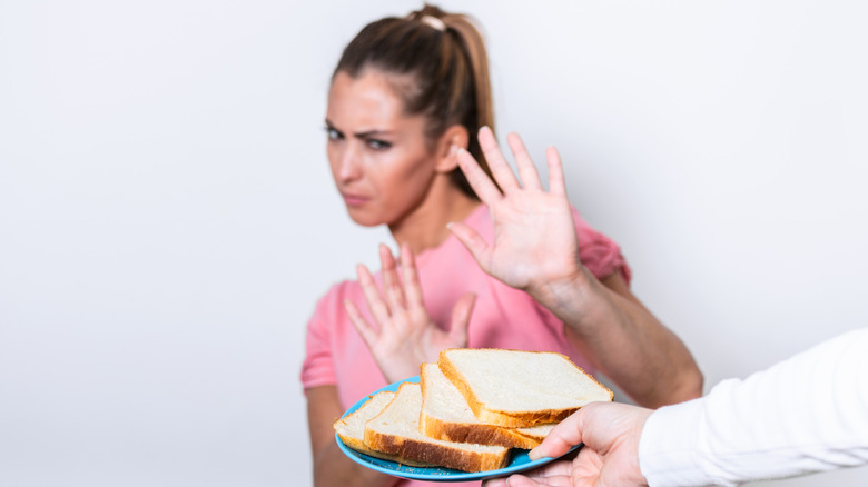 woman rejecting slices of bread