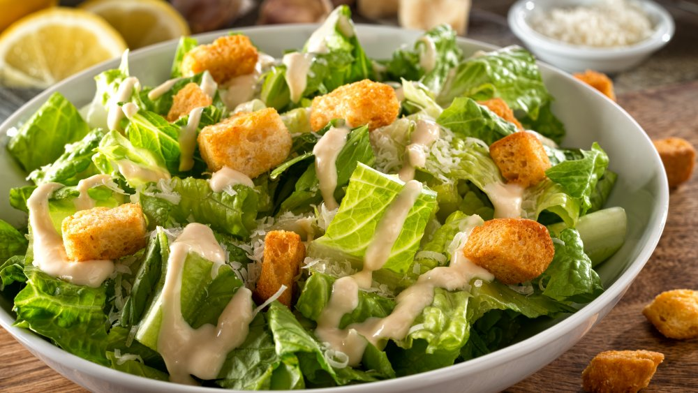 A bowl of salad with dressing