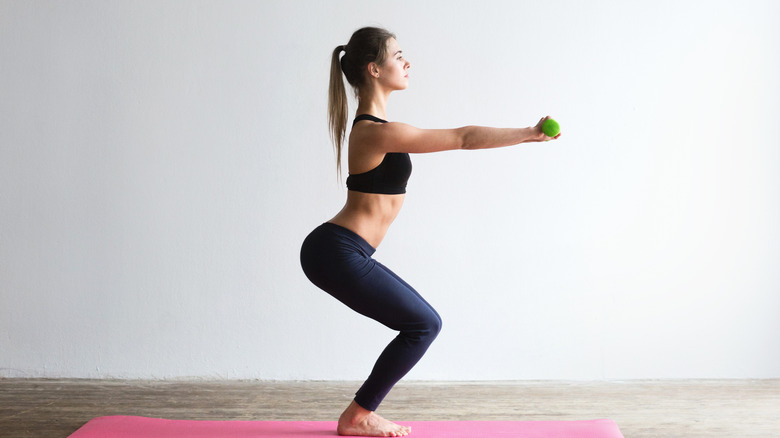 woman mid-squat