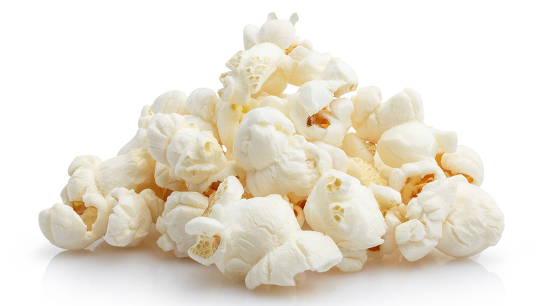 Close up of popcorn on a white background
