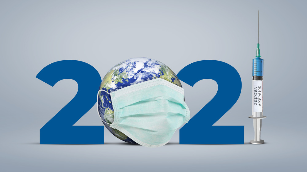 The numbers 2021 with a globe for the zero and a syringe for the one