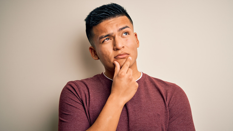 Man thinking with fingers on chin