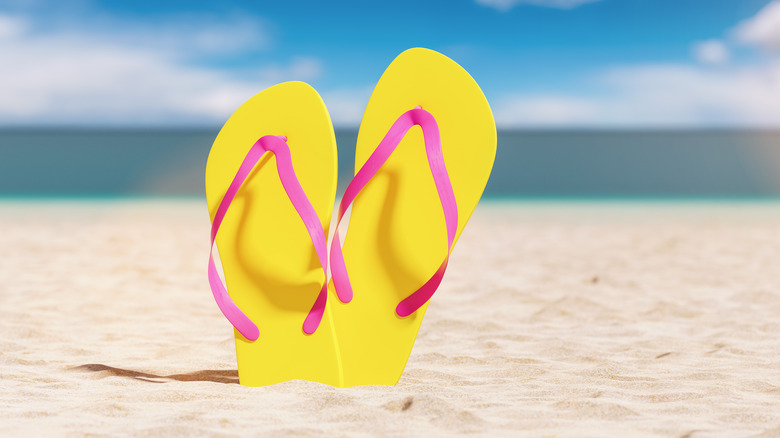 Yellow and pink flip flops on the beach