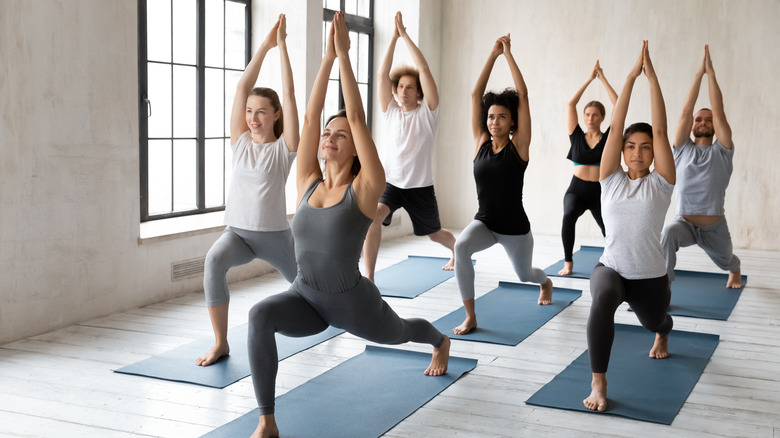 A yoga session consisting of mostly women