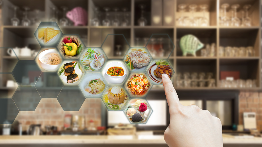 Person ordering food on a restaurant menu using virtual reality