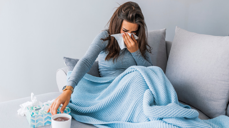 sick woman after a breakup