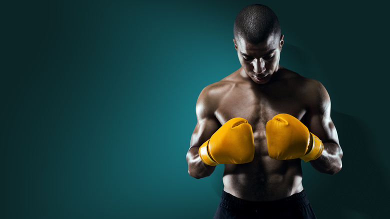 male athlete with boxing gloves