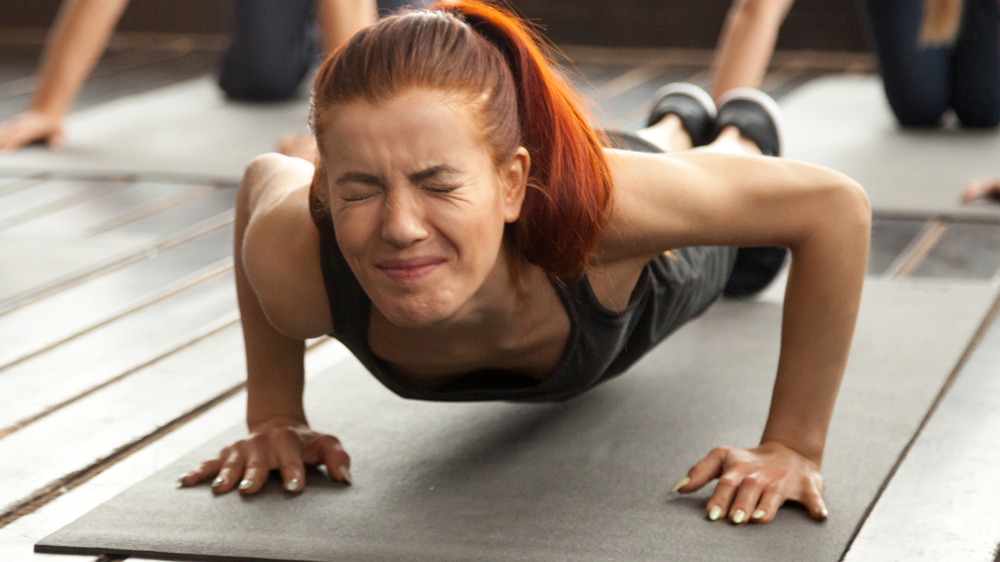 Woman struggling to do pushup