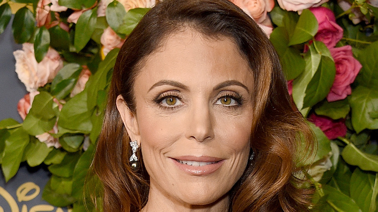 Bethenny Frankel posing with roses in the background