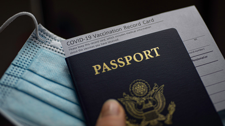A COVID-19 medical card tucked in a US passport
