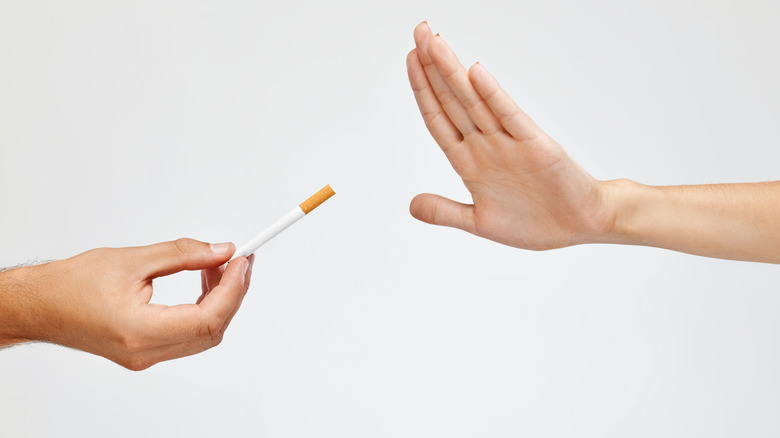 hand saying no to a cigarette