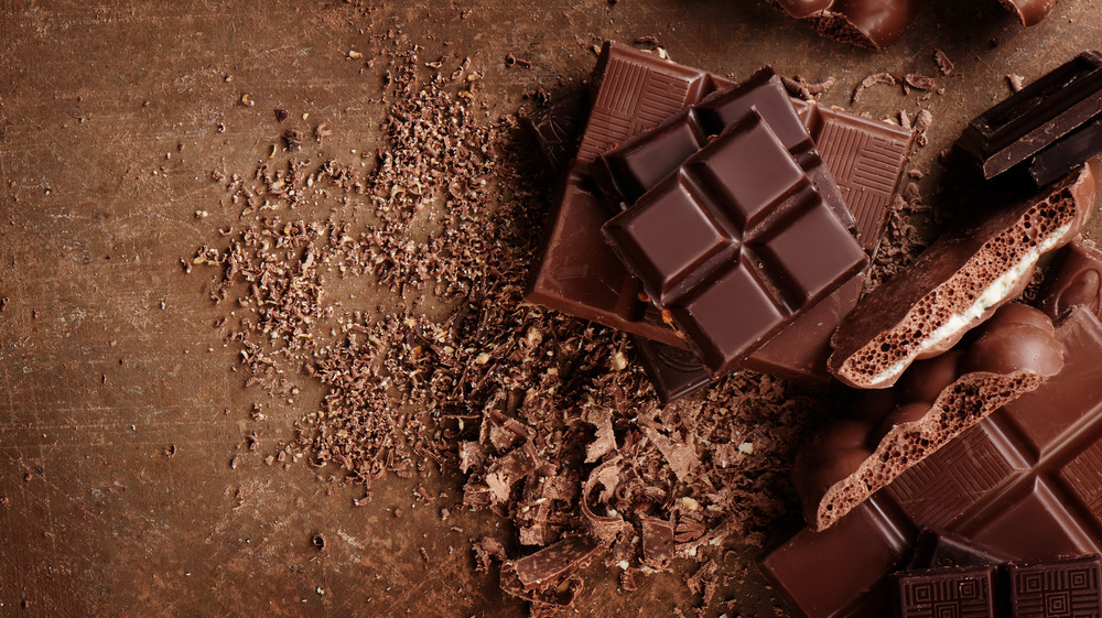 bricks of chocolate on a matching brown background
