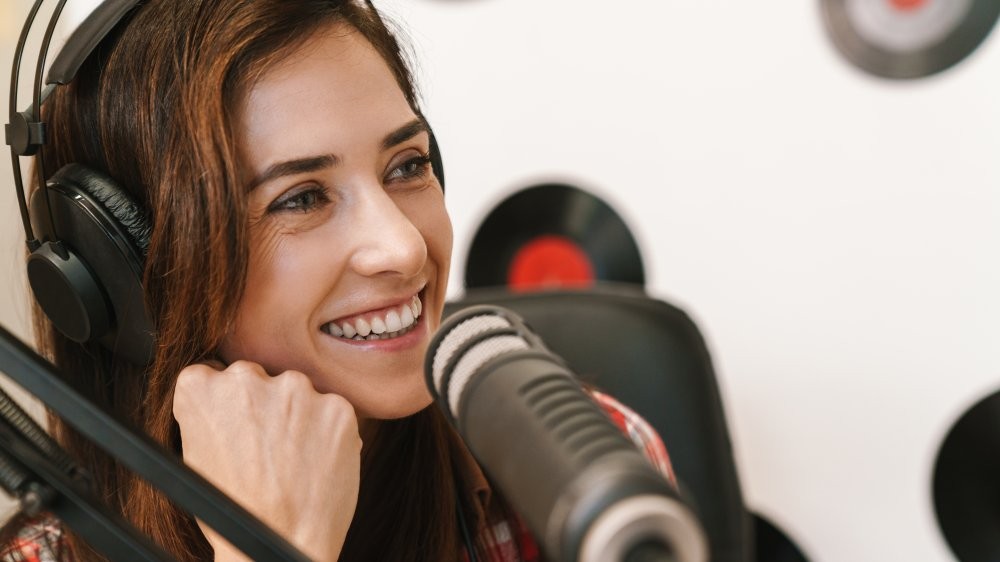 Smiling woman speaking into a microphone