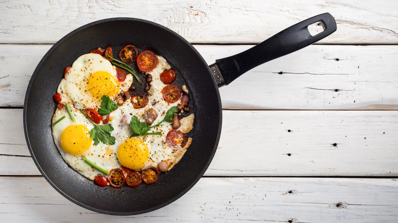 Bacon and eggs cooked in a pan